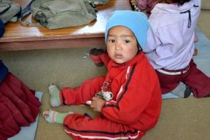 Un bambino nella scuola di Bak